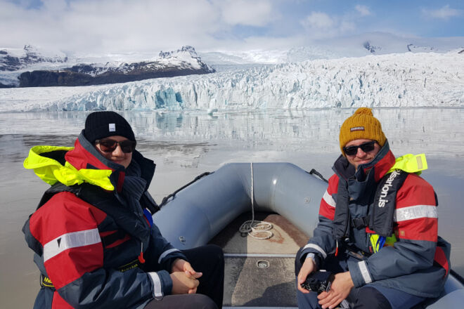 Passangers on a boat tour on a glacier lagoon.